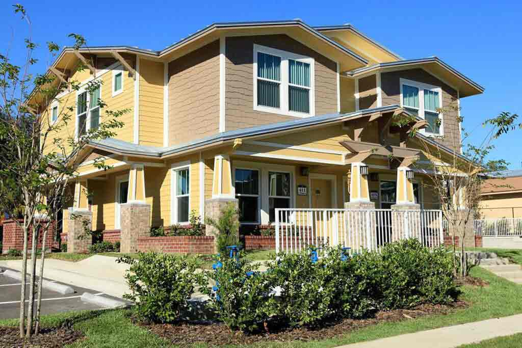 Oak Ridge Estates yellow and brown two story building